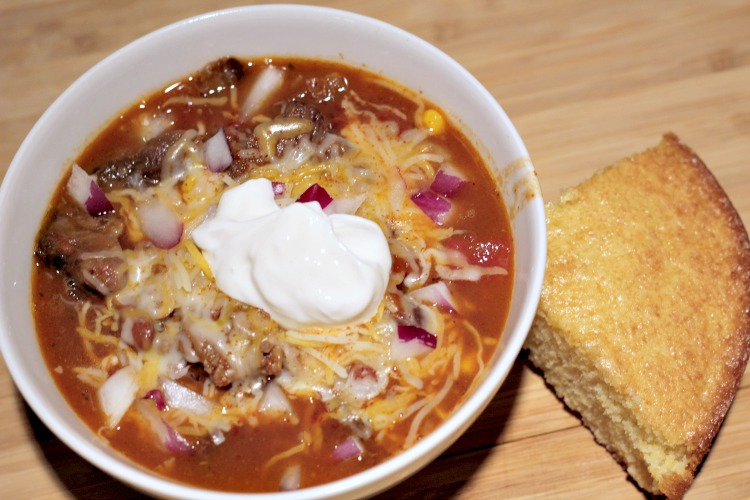 This Crockpot Prime Rib Chili Recipe is the perfect way to use up leftover prime rib from your holiday dinner! Throw in the crockpot and allow it to cook!