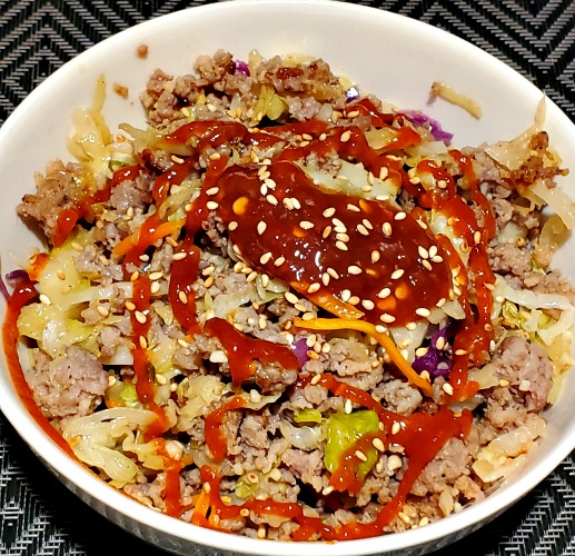 This Eggroll In A Bowl On The Blackstone Griddle is the perfect quick and easy weeknight dinner to make on the Blackstone! It will be a family favorite weeknight dinner and it's also low carb for keto!