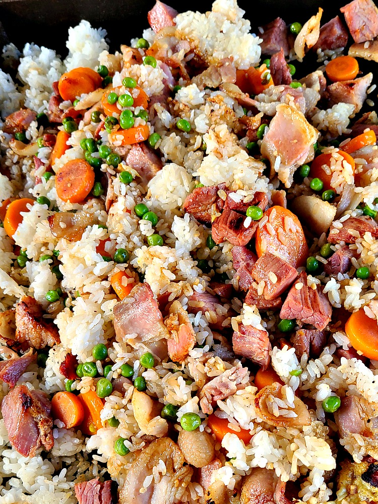 Ham Fried Rice On Blackstone Griddle is the perfect way to use up leftover holiday ham! Add in bacon for more flavor, and an easy leftover dinner to make!