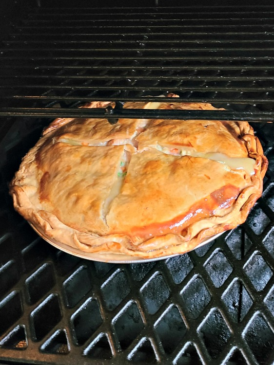 Smoked Chicken Pot Pie Recipe is the perfect comfort food to make on a pellet grill!! Smoke flavor is amazing on the crust and the chicken in the pot pie.