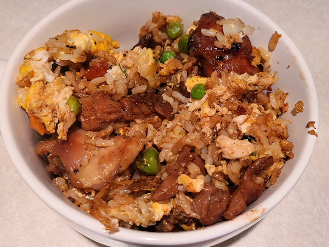 Teriyaki Chicken Fried Rice On The Blackstone Griddle! Use a teriyaki sauce and marinade to flavor the chicken thighs into the fried rice on the griddle. Using cold rice makes for amazing fried rice on a Blackstone Griddle.  The chicken and the sauce adds amazing flavor to the fried rice.