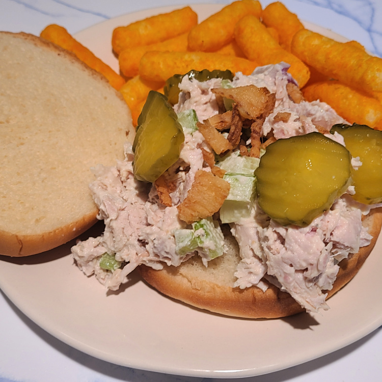 Smoked Turkey Salad Recipe is the perfect way to use up the leftover smoked turkey from holiday dinners! The flavor of the smoked turkey adds to the lunch salad! You can add in different ingredients to change up the flavor, peppers, olives, spices, spicy mustard, and so much more! Goes perfect on a bun for a leftover lunch!