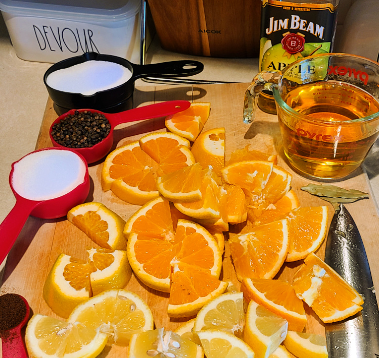 Bourbon Turkey Brine For Smoking Turkey! Perfect to make with Jim Beam Apple Bourbon, plus fruit in the brine and a butter injection! This bourbon brined turkey makes for perfect Thanksgiving dinner!