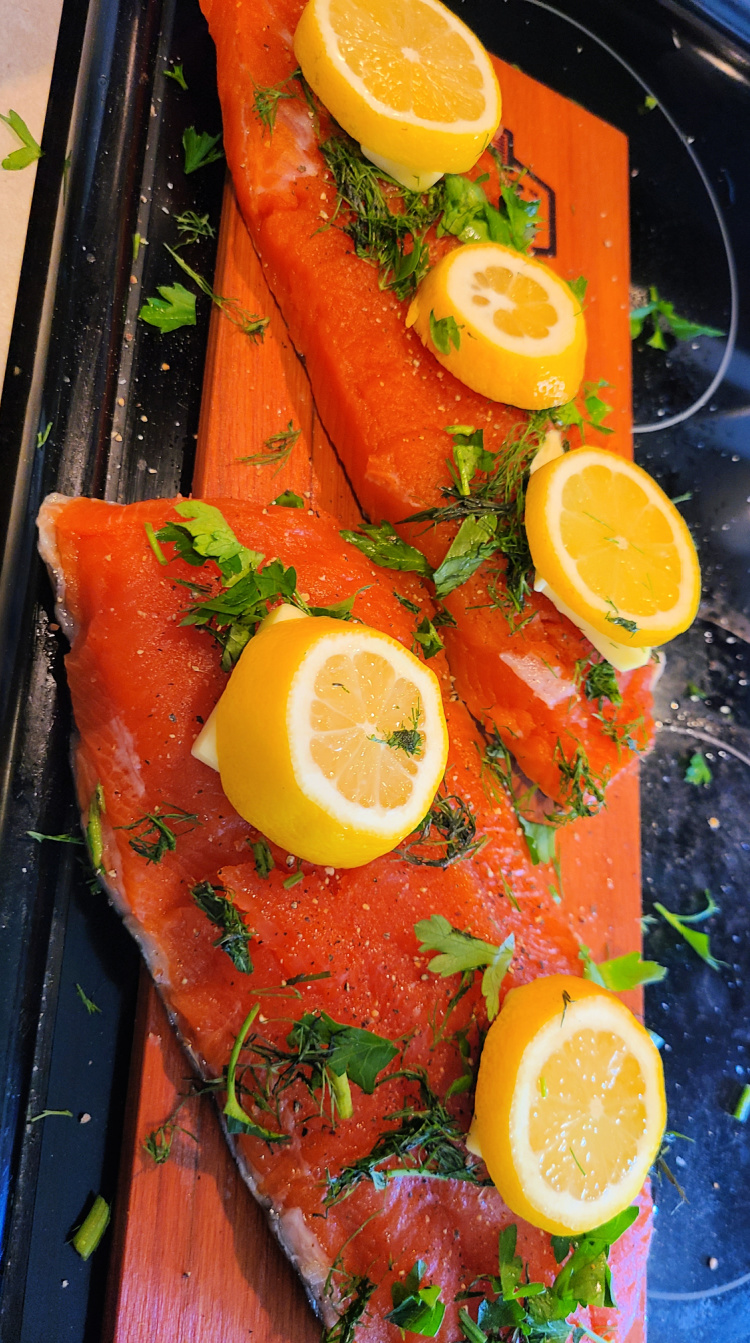 This Pit Boss Cedar Plank Salmon made with dill and parsley is amazing! Throw on butter and lemon as well to make a moist and flavorful smoked salmon! Smoke this on a Pit Boss Pellet Grill or electric smoker for the perfect dinner!